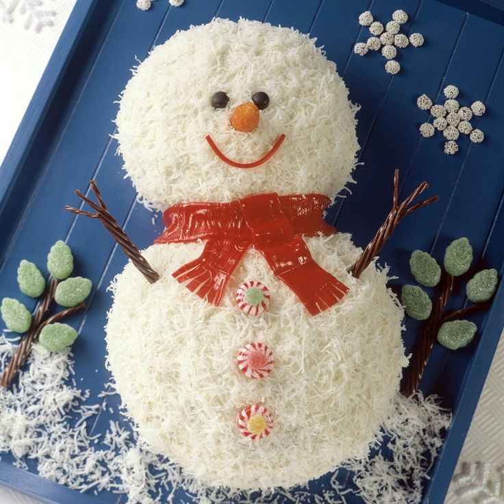 This adorable Snowman Celebration Cake Recipe makes a cake that is almost too cute to eat! It's also completely delicious!