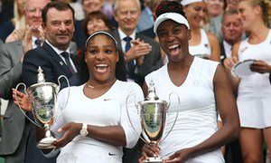 Serena Williams (left) and her sister Venus show off their trophies after they won the 2016 Wimbledon women's doubles title