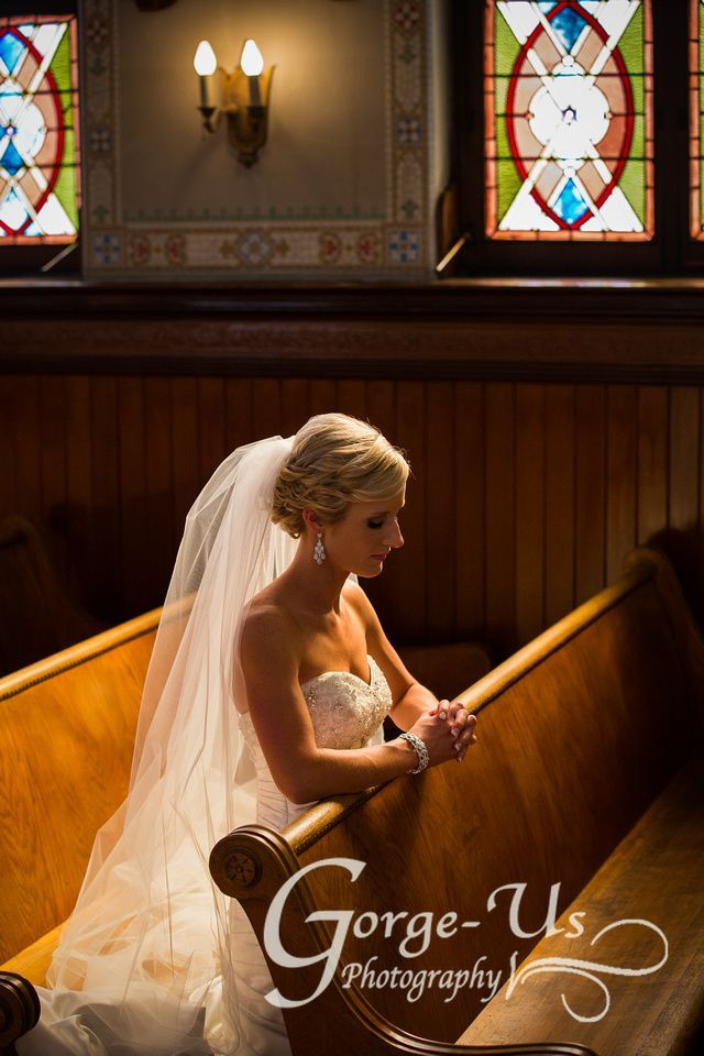 Light shining on bride sitting in church before ceremony.     Wedding photo idea: bridal portrait in church Photo by: Gorge-Us Photography Columbia Gorge & Hood River Wedding Photography
