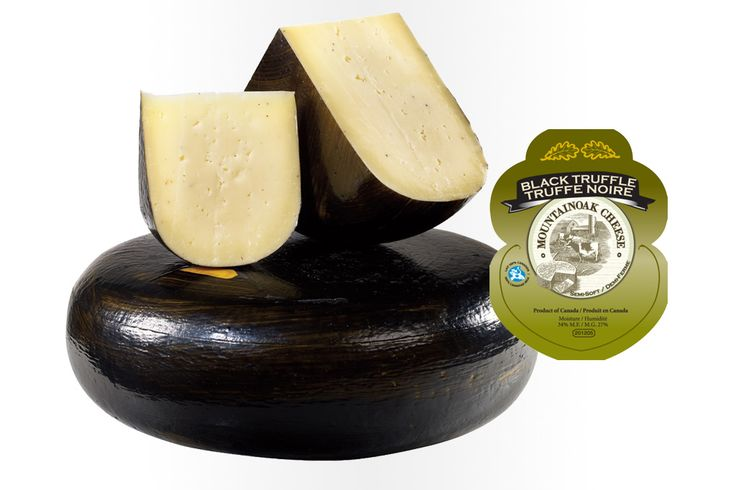 """Mountain Oak """"Black Truffle"""" Gouda Cheese: Uniquely aromatic and often thought of as a cheese to be saved for special occasions. This cheese has a flavour that separates it from all others. A gourmet product for connoisseurs of fine food. Ingredients: Whole milk, black truffle, bacterial culture, salt, calcium chloride, rennet."""