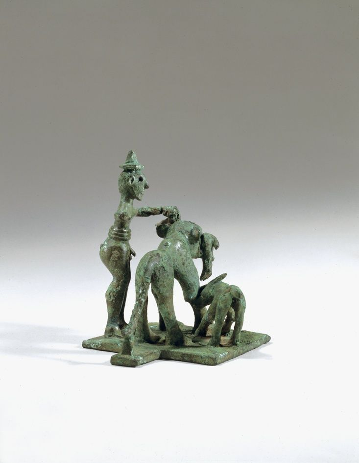 Greek bronze statuette with shepherd, Geometric period, 725 B.C. Probably Laconian, from Pisa near Olympia. A votive offering, recalling Homeric similes involving shepherds and attacking lions, 10.2 cm high. George Ortiz collection