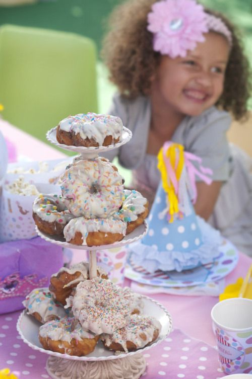 """Carnival party: A doughnut """"tree"""" will delight young and old and is a perfect centrepiece. Buy plain doughnuts and ice them in the colours of your theme."""