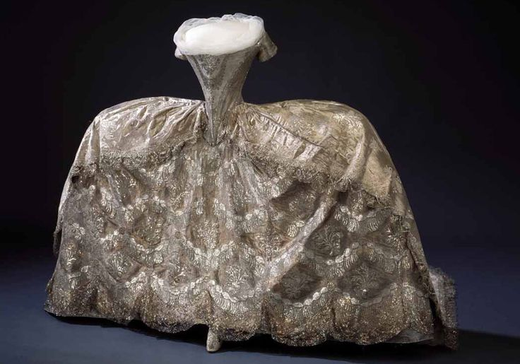 Silver tissue and lace wedding gown worn by Hedwig Elizabeth Charlotte Holstein-Gottorp when she married her cousin, the future King Charles XIII of Sweden on July 7, 1774, (around four years after Marie Antoinette's wedding day at Versailles).  Her waist -- 19 inches !