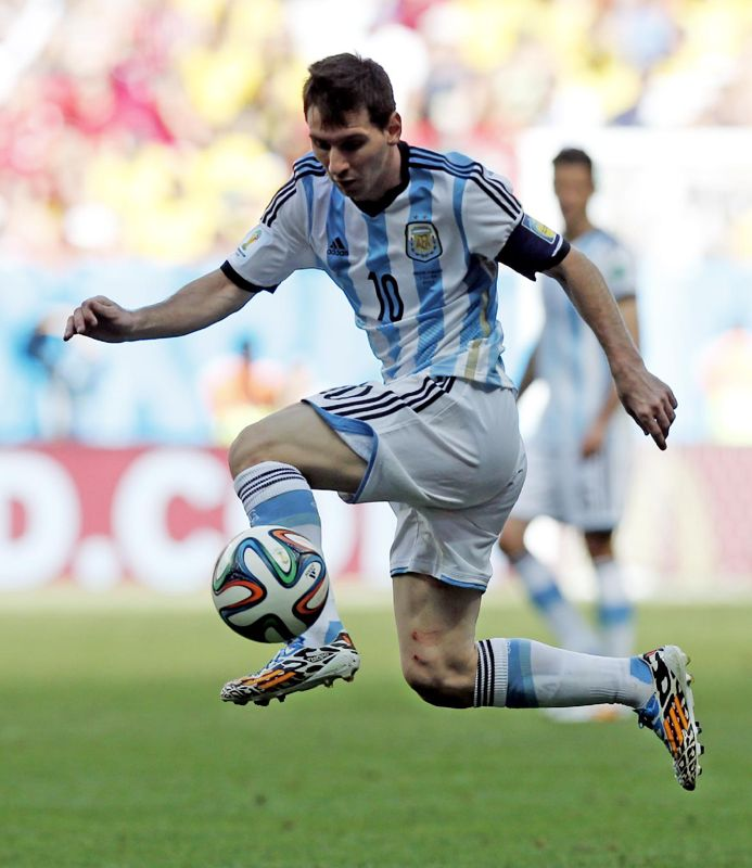 Argentina's Lionel Messi leaps the catch a pass during the World Cup quarterfinal soccer match between Argentina and Belgium at the Estadio Nacional in Brasilia, Brazil, Saturday, July 5, 2014.