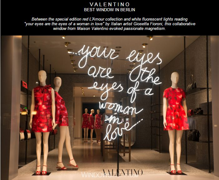 """V A L E N T I N O BEST WINDOW IN  BERLIN                                                                                     Between the special edition red L'Amour collection and white fluorescent lights reading """"your eyes are the eyes of a woman in love"""" by Italian artist Giosetta Fioroni, this collaborative window from Maison Valentino evoked passionate magnetism."""