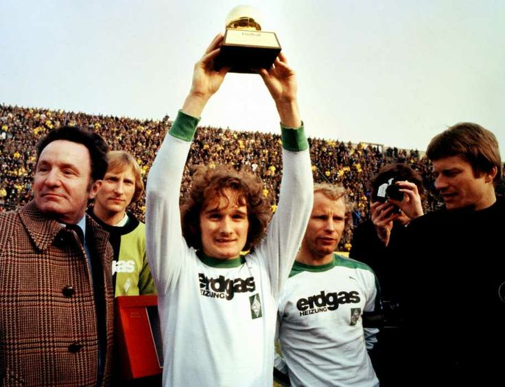 """Allan Simonsen (Borussia Mönchengladbach, 1972–1979, 178 apps, 76 goals) and (Denmark, 1972–1986, 55 caps, 20 goals). Player of the year and Ballon d'Or 1977. Simonsen is the only player not to qualify after winning the prestigious award Ballon d'Or ...so far. Just behind on the right, Hans-Hubert """"Berti"""" Vogts (Borussia Mönchengladbach, 1965–1979, 419 apps, 32 goals)."""