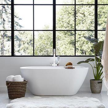 Sheepskin Pelt Rug in Front of Oval Bathtub
