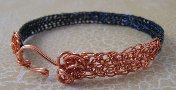 This bracelet is viking knit weave which I pressed flat. The copper piece was my starting part for the navy viking knit. I didn't want to waste a perfectly good piece of copper so I decided to incorporate it into a bracelet!