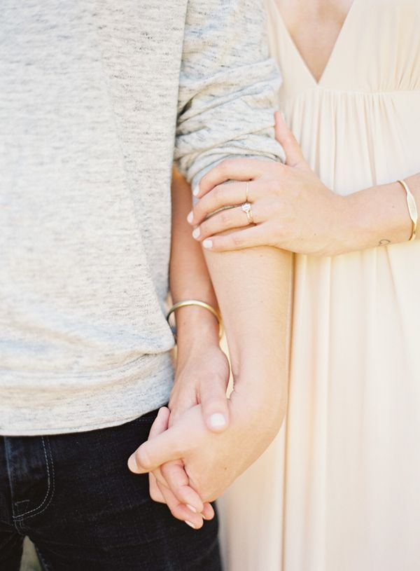 Perfect engagement photo pose. You can see the bride's pretty engagement ring!