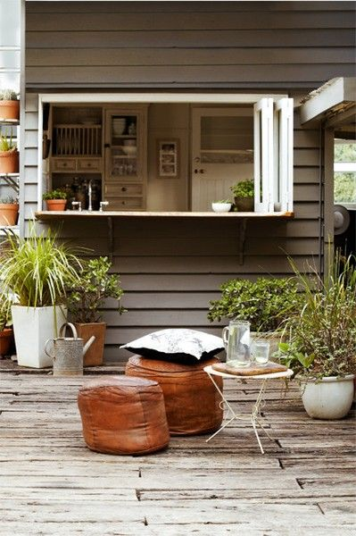 How cool is this? An al fresco style dining counter set up at your kitchen window with seating on the deck.