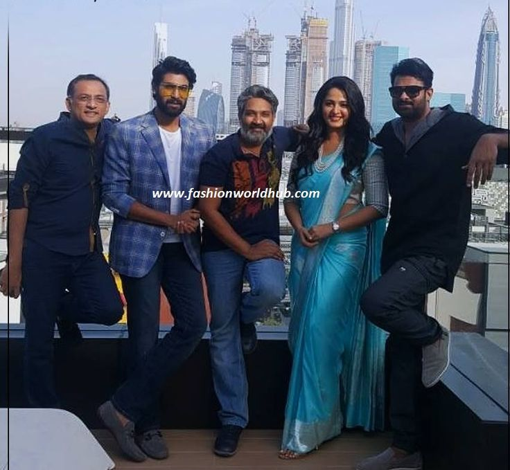 Anushka shetty and baahubali team at dubai for the promotion of baahubali 2. Ravishing Anushka shetty was spotted in sky blue banaras silk saree teamed with silver elbow length sleeve blouse and is designed by shravan kumar . She completed her look with pearl necklace and wavy hair.From left SS Rajamouli, prabhas, Anushka sheety, Rana daggupati and designer Shravan kumar.Lovely pose at dubai