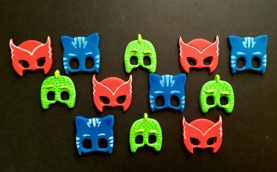 Edible Dozen of PJ Masks themed fondant cupcake by SabzCakes