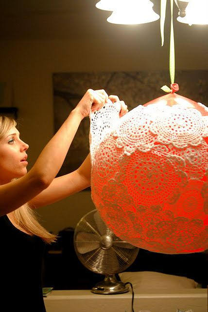 OMG DIY at its best! Doily lamp with a huge balloon and wallpaper paste. Once dry, after a few days, pop the balloon and hang with a basic lamp kit from the ceiling.