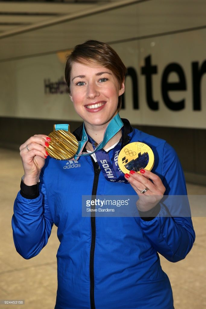 Lizzy Yarnold of Great Britain poses with her Skeleton gold medals from Sochi 2014 and PyeongChang Winter Games during the Team GB Homecoming from the Winter Olympics at Heathrow Airport on February 26, 2018 in London, England.