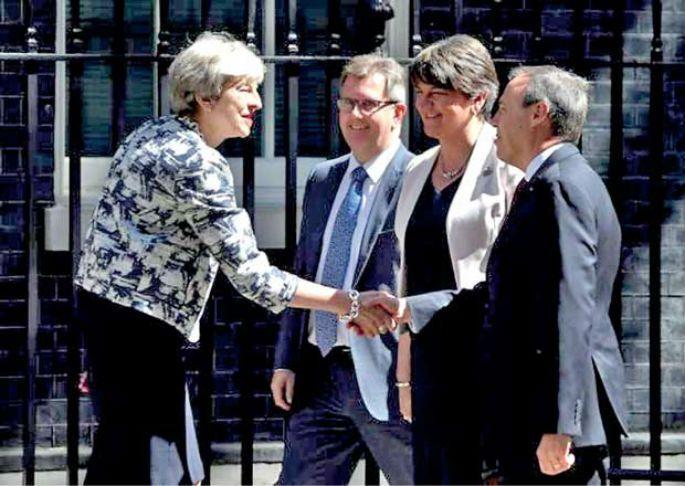 May strikes $1.3 billion deal for support from Northern Irish party #TheresaMay #UnitedKingdom #Yaalaruvi #யாழருவி  Learn more: www.yaalaruvi.com
