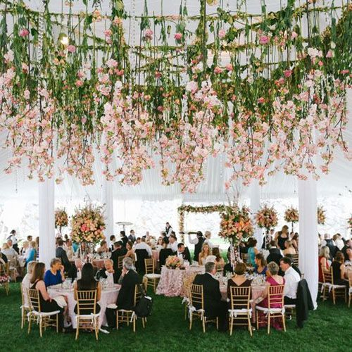 Hanging Floral -- We pretty much swoon over any wedding with flowers hanging from the ceiling. So this tented reception is no exception. Your average garden party, only, way better.