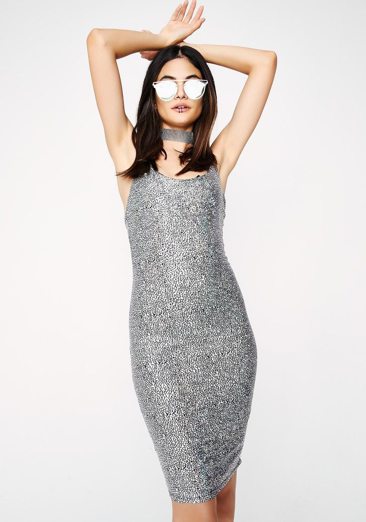 Never Average Bodycon Dress you're the life of every party, babe! This silver bodycon dress has spaghetti straps and a low cut back.