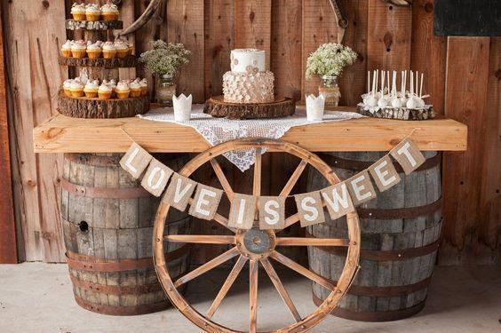 rustic wedding dessert ideas with wagon wheel / http://www.deerpearlflowers.com/rustic-country-wagon-wheel-wedding-ideas/