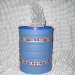 Formula tin->  pull trash bags from diy hole in lid. could be used in car, etc.