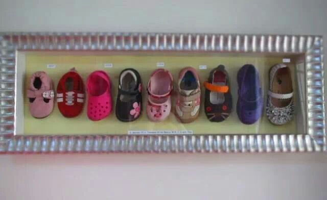 Keep baby/kid shoes display in a shadow box frame. Great memories
