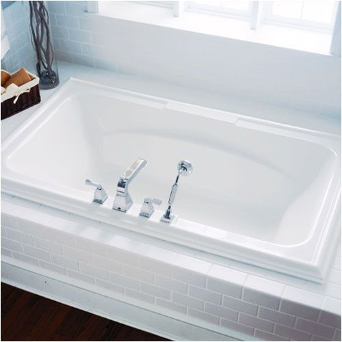 1000 ideas about large bathtubs on pinterest master for How big is a standard tub