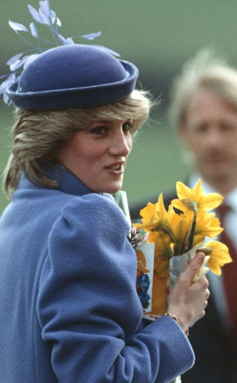 Princess Diana in Leckhampton, Gloucestershire in the early months of her pregnancy with Prince Harry wearing a Catherine Walker lilac wool coat & a small velvet skull hat with decorative feathers by Frederick Fox.