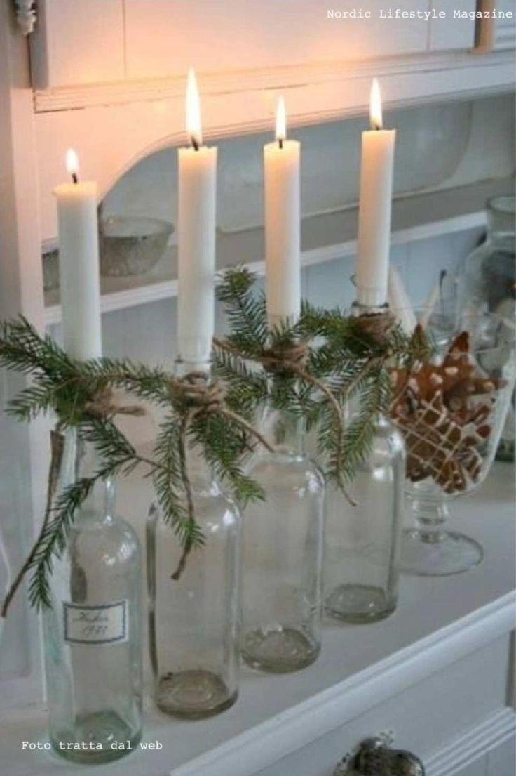 Haal de etiketten van lege flessen af, stop er een kaars in en versier iedere fles met wat kerstgroen uit de tuin! En je hebt prachtige versiering/adventskaarsen.