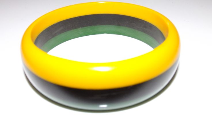 "Jamaican striped skinny bangle. 2 7/8"" opening. Made of acrylic."