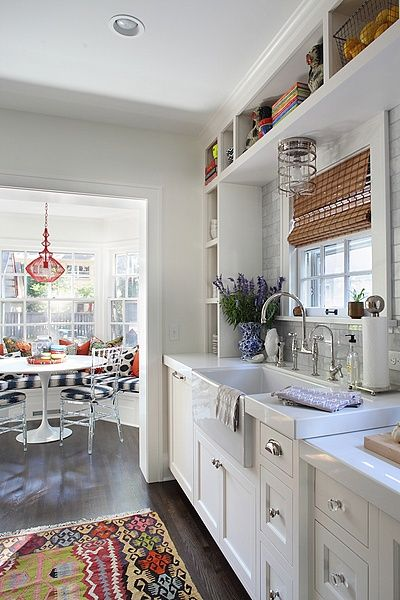 This kitchen with the added breakfast nook is so cute and functional. Loving the lightness of the walls and cabinetry with the pops of color throughout. /ES
