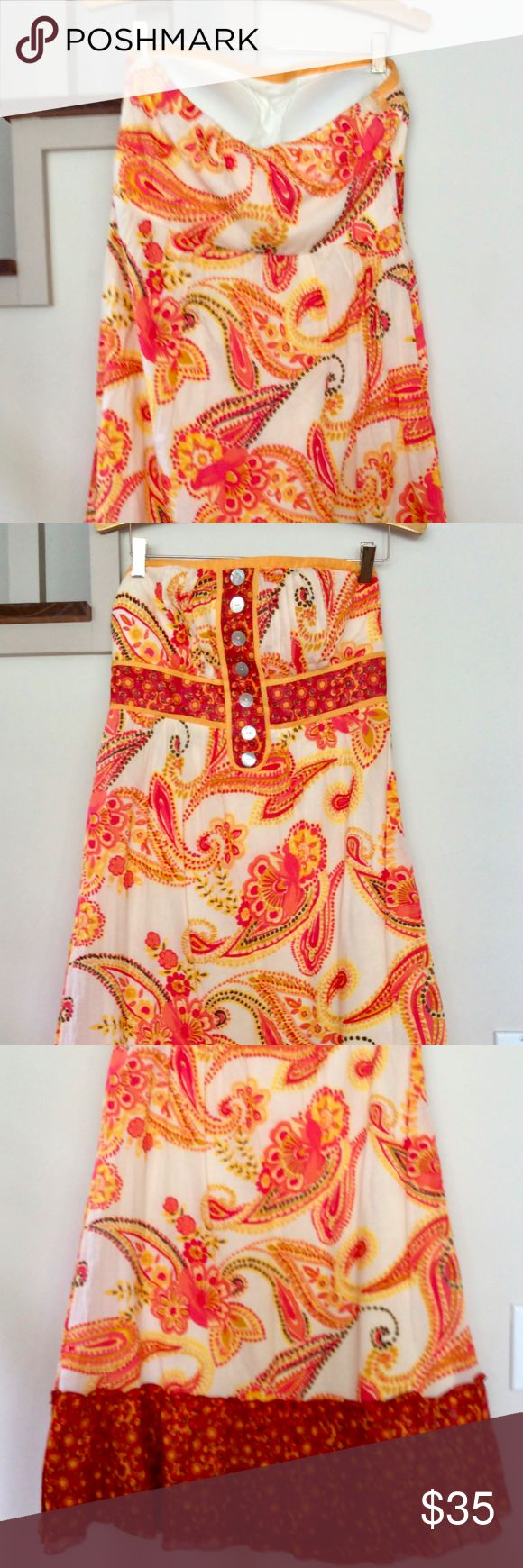"""Sangria  Orange Paisley Print Strapless SunDress Multi Floral Strapless Indian paisley Sundress in orange, red and yellow on a cream background. 6 buttons down the middle, Red Ruffle on the bottom.  Side zipper,  dress is fully lined, 100% Cotton, made in India  Size: 12. Length (shoulder to bottom edge): 36"""" . Width (from under one arm to the other): 16"""".  I think this is cut small so please read the measurements carefully.  The wide skirt is swirly and flirty.  Cool comfortable and eye…"""