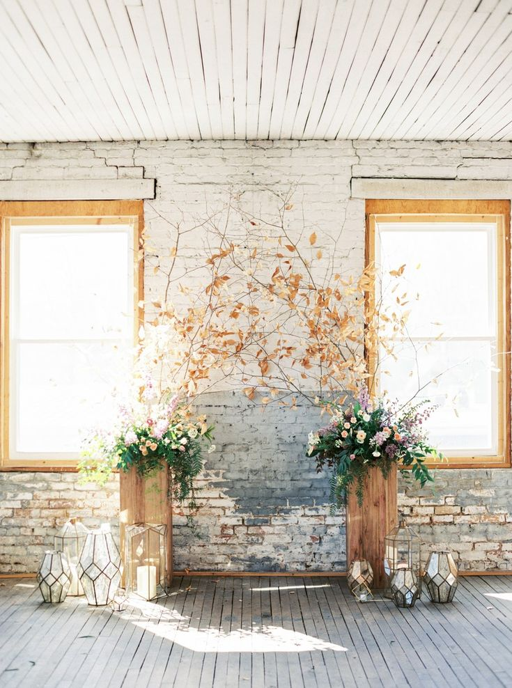 This ceremony structure is a great inspo for those of you planning a fall wedding indoors. This example looks especially nice as the warm hue coordinates with the worn brick walls and light-filled windows.