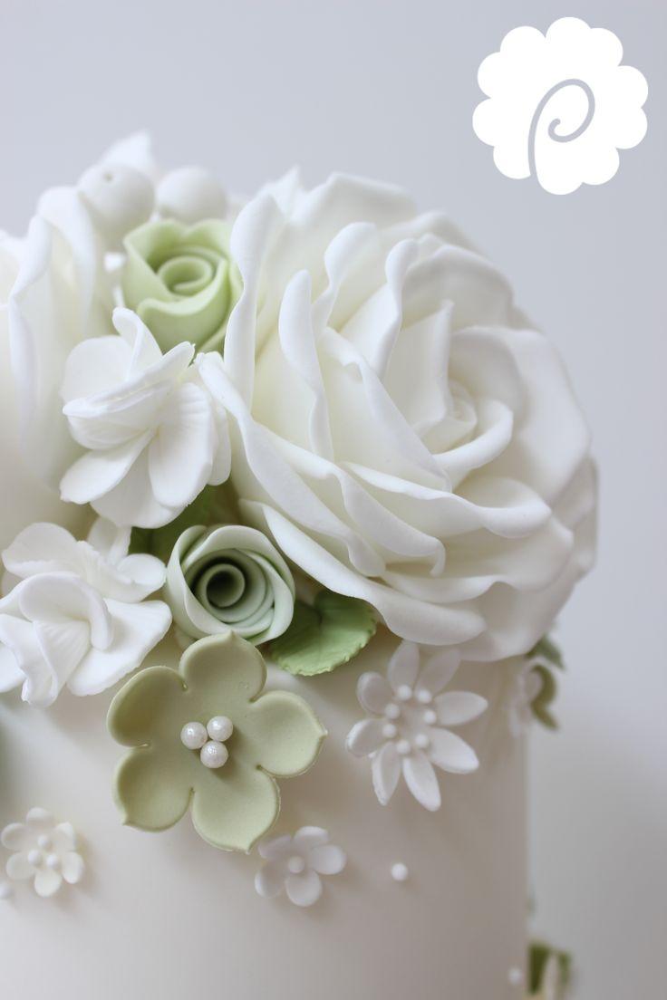 White and soft green rose wedding cake