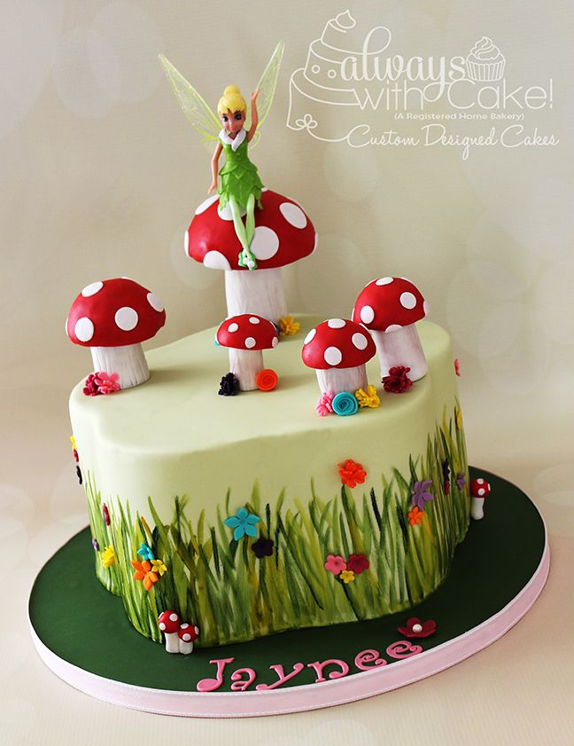 Fairy Garden Cake - I had never got a chance to use my petal pan, so I was excited, when asked to do a fairy theme cake....I knew it was finally time. Grass is hand painted, flowers are made out of fondant and toadstools are made out of rice cereal treats. TFL