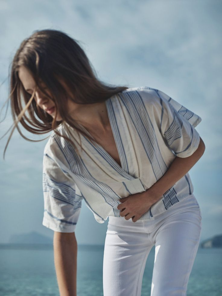 Get that structured striped blouse and those fitted skinny white jeans