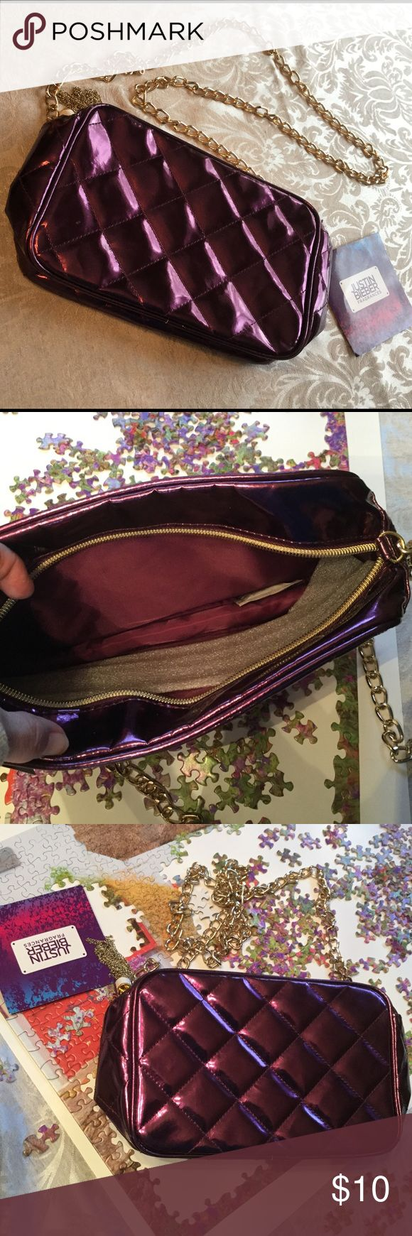 """🆕 Justin Bieber Limited Edition Bag ! 💜 Justin Bieber Limited Edition ! It's about 9 1/2 by 6"""" by 3"""" ! Nice size ! Never used ! A gold tone chunky 52"""" chain ! Cross body or shoulder bag ! Quilted PVC inside is polyester lining ! Adorable zip tassel ! Glossy purple ! From Macy's ! 💜 Justin Bieber Bags"""