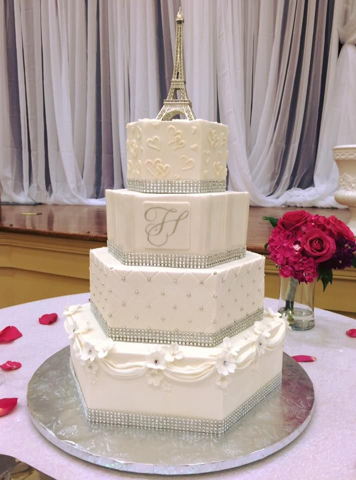 Silver and White Hexagon Wedding Cake by Cindy's Cakery //  silver dragees, drapes, crystal centered flowers, bling, Eiffel Tower topper, handpainted monogram // Williamsburg weddings // Va Weddings //