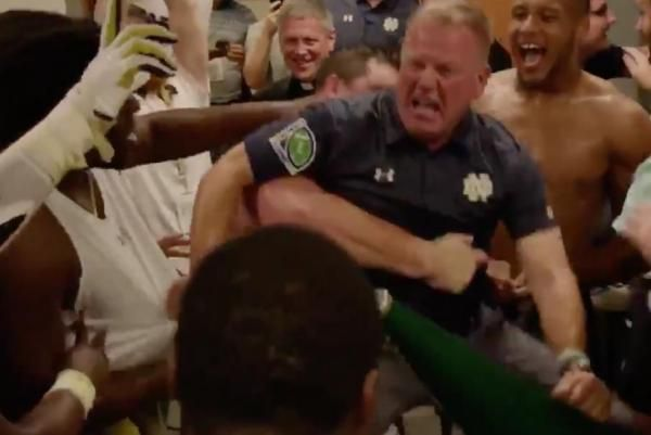 Notre Dame coach Brian Kelly celebrated Saturday's win against Michigan State by dancing in a scrum with his team in the locker room.