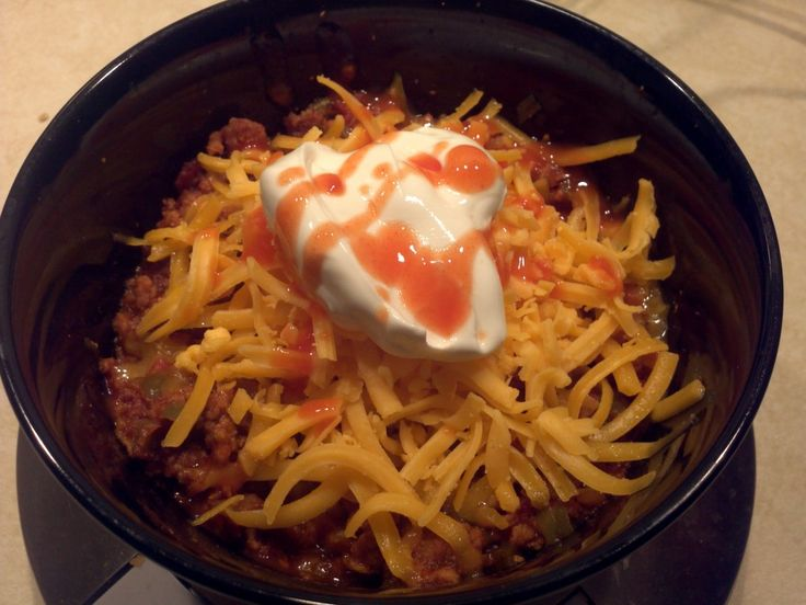 Caveman Chili topped with cheese, sour cream and frank's red hot Ingredients:  8 Thick cut bacon 40 oz Ground Pork 300 g Yellow Onion (1 medium onion) 300 g Green Pepper (3 small peppers) 6 oz Tomato Paste 1 can Diced Tomatos 1 pack Mccormick Originial Chili Seasoning To taste Salt, pepper and garlic powder, onion powder, cayenne pepper