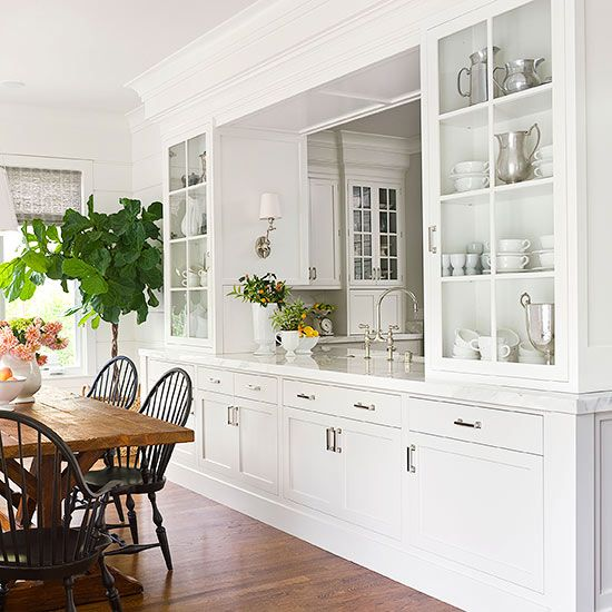 A stunner! A pass-through framed with generous double-sided wall cabinets for display and extra storage in base cabinets crowned with gorgeous thick marble counter. via:bhg
