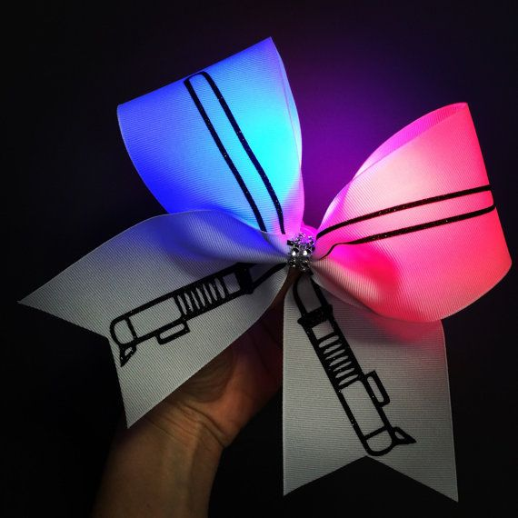 Light up LIGHTSABER Cheer Bow! Red and Blue lights glued inside that can be turned on and off. Stiff! Ponytail holder attached! Free shipping