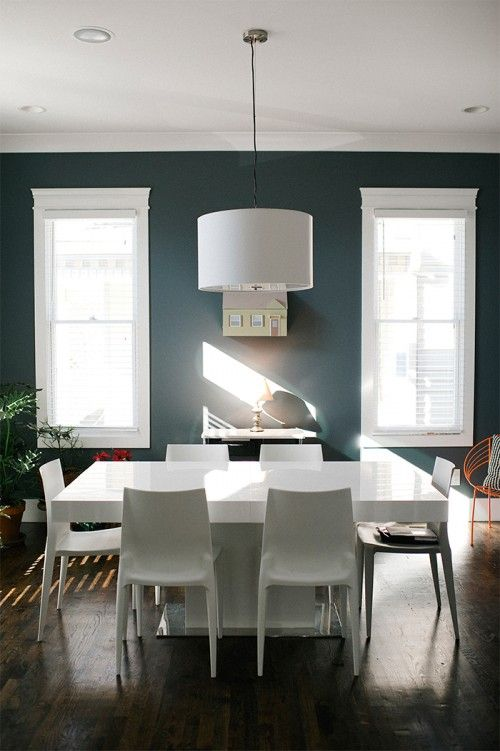 We chose the dining table to echo some of the lines from the open shelves in the kitchen, and love using it to host intimate gatherings. Walls are Sherwin Williams Web Gray and trim/ceiling is Sherwin Williams Extra White.