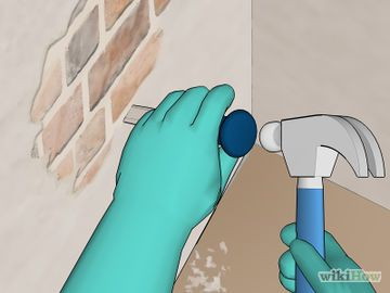 How to expose brick wall - removing plaster from a room!