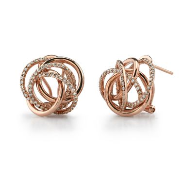 Swirling rose gold earrings with diamonds.