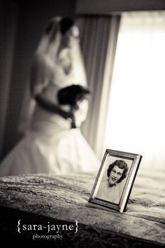 great photo idea for loved ones lost at wedding.  {I wish I would have done this for my wedding with my mom's picture - we didn't even get a picture of the table that held all of our loved ones pictures :'( }
