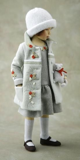 Just make some felt flowers, sew them on your little girls coat and then add some green stiches to look like stems.  ADORABLE!