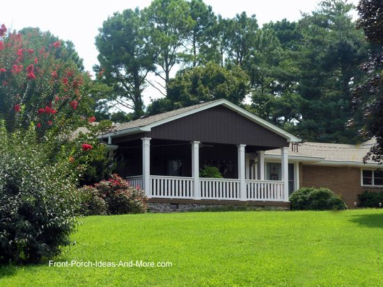 A Large Gable Roofed Front Porch Added To A Ranch Style Home Helps Connect To The