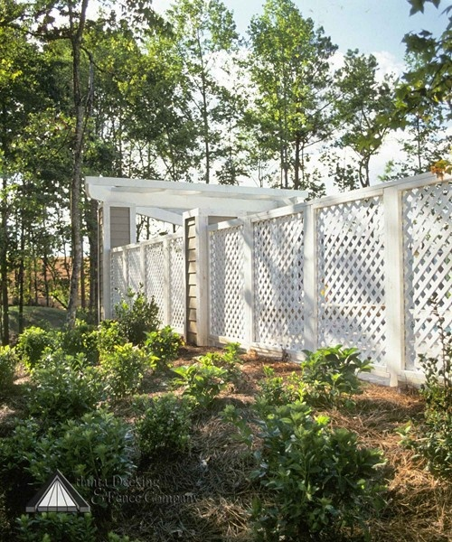 Charming white privacy screen fence hides an inground pool for Privacy screen for pool