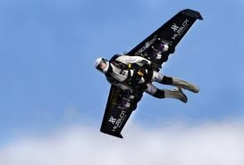 Rocket Man Yves Rossy with jet propelled wings strapped to his back!
