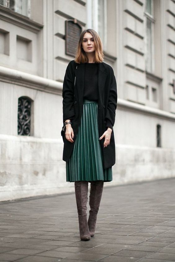 Incredibly dark green pleated long skirt, elegant woman brown shoes