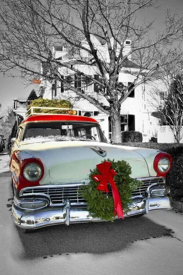 Red And White Car With Christmas Wreath Tied To The Front A Tree Top Home For Holidays Photograph
